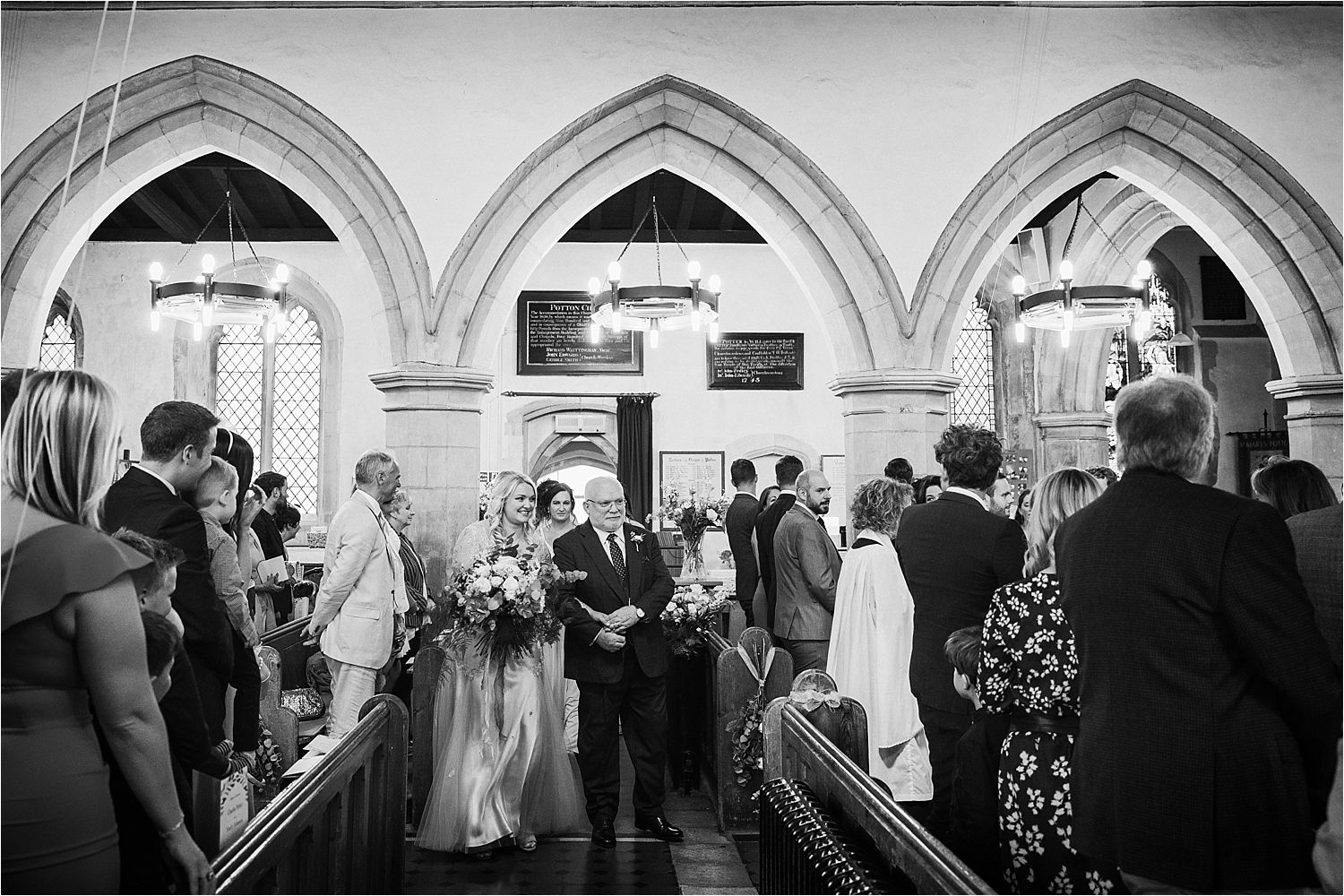 Bride and her father arriving in church for Bedfordshire wedding
