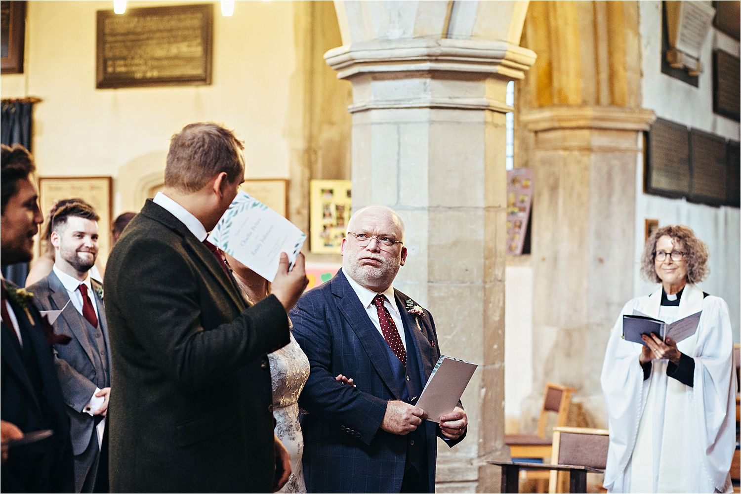 Groom at altar fans himself with order of service