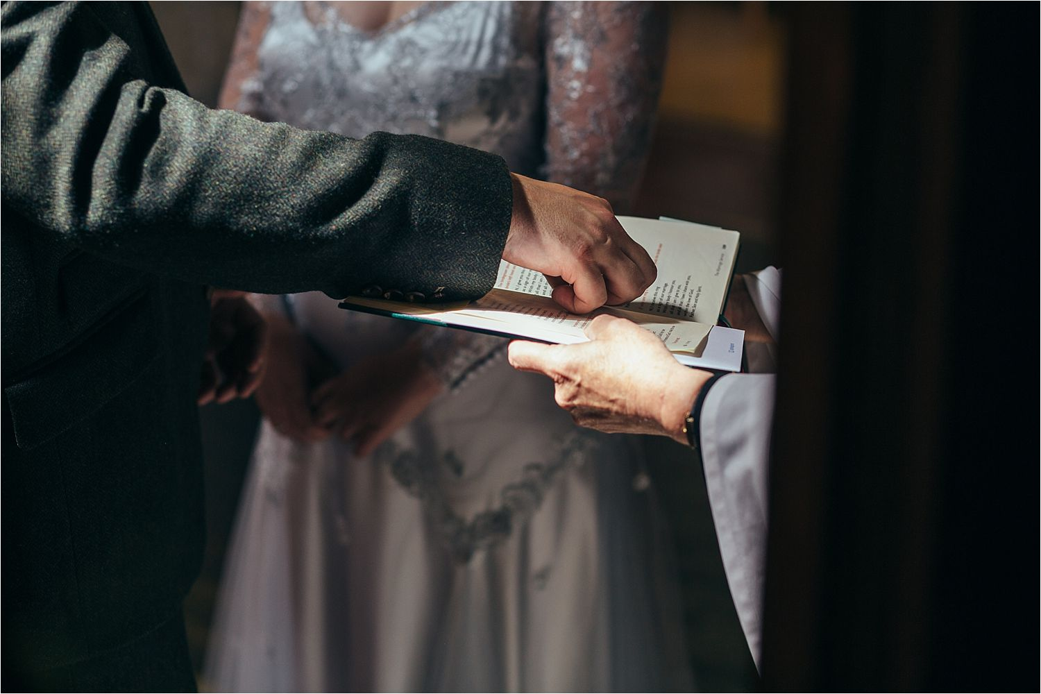 Best man places rings on hymn book during wedding ceremony in Bedfordshire