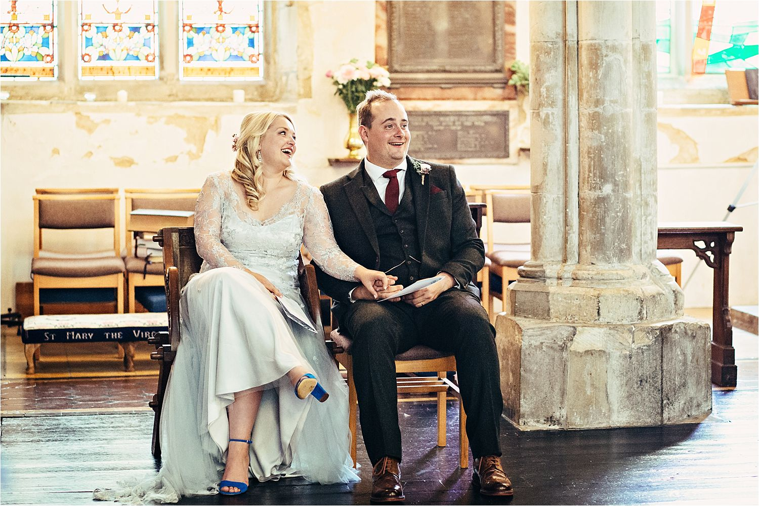 Bride and grrom have a relaxing moment during wedding ceremony in Bedfordshire church