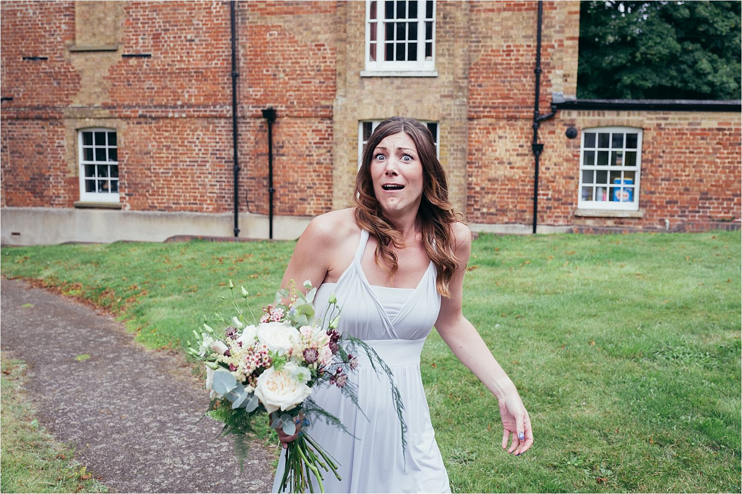 Bridesmaid on own outside church