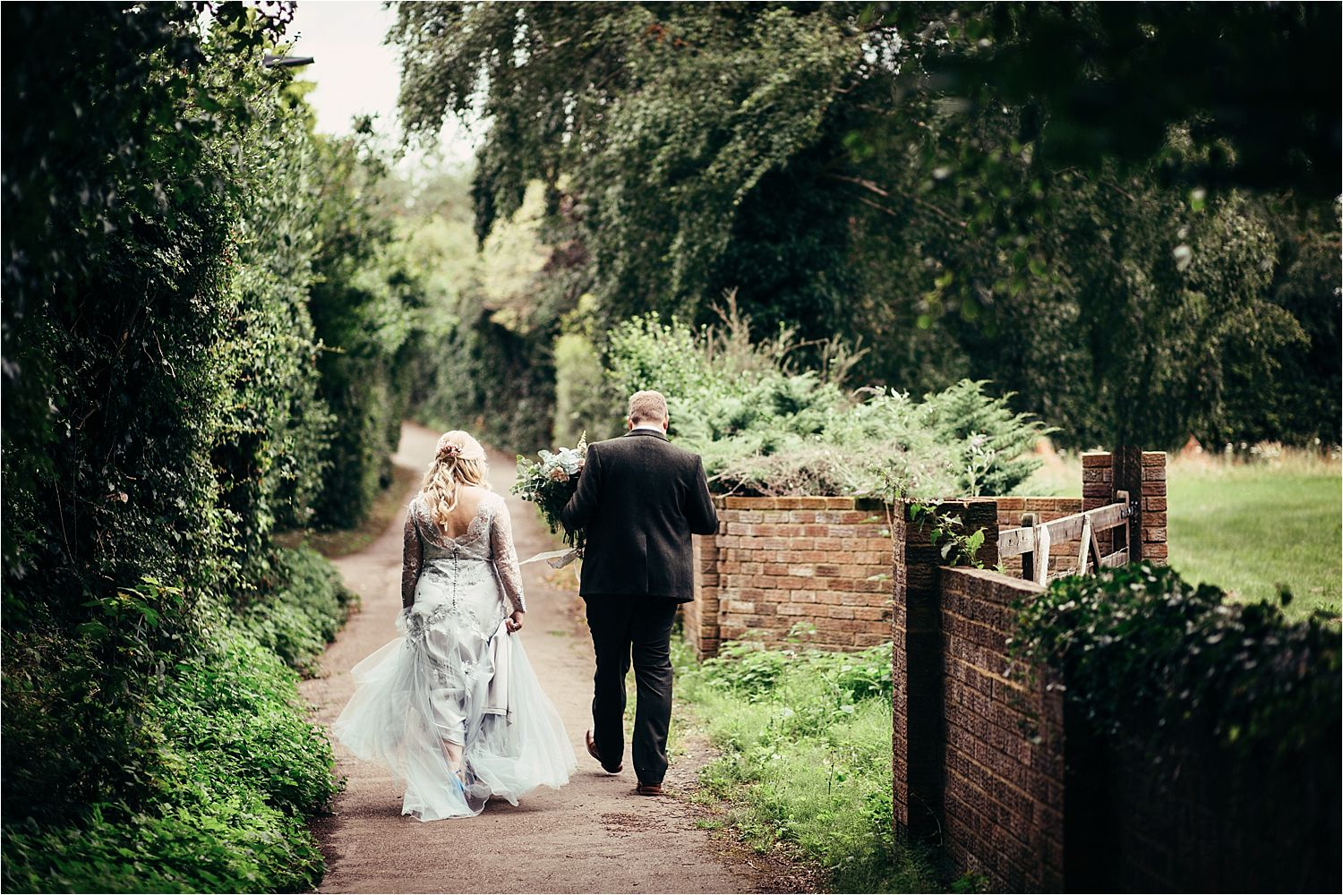 Bride and groom walk back to reception in Bedfordshire wedding