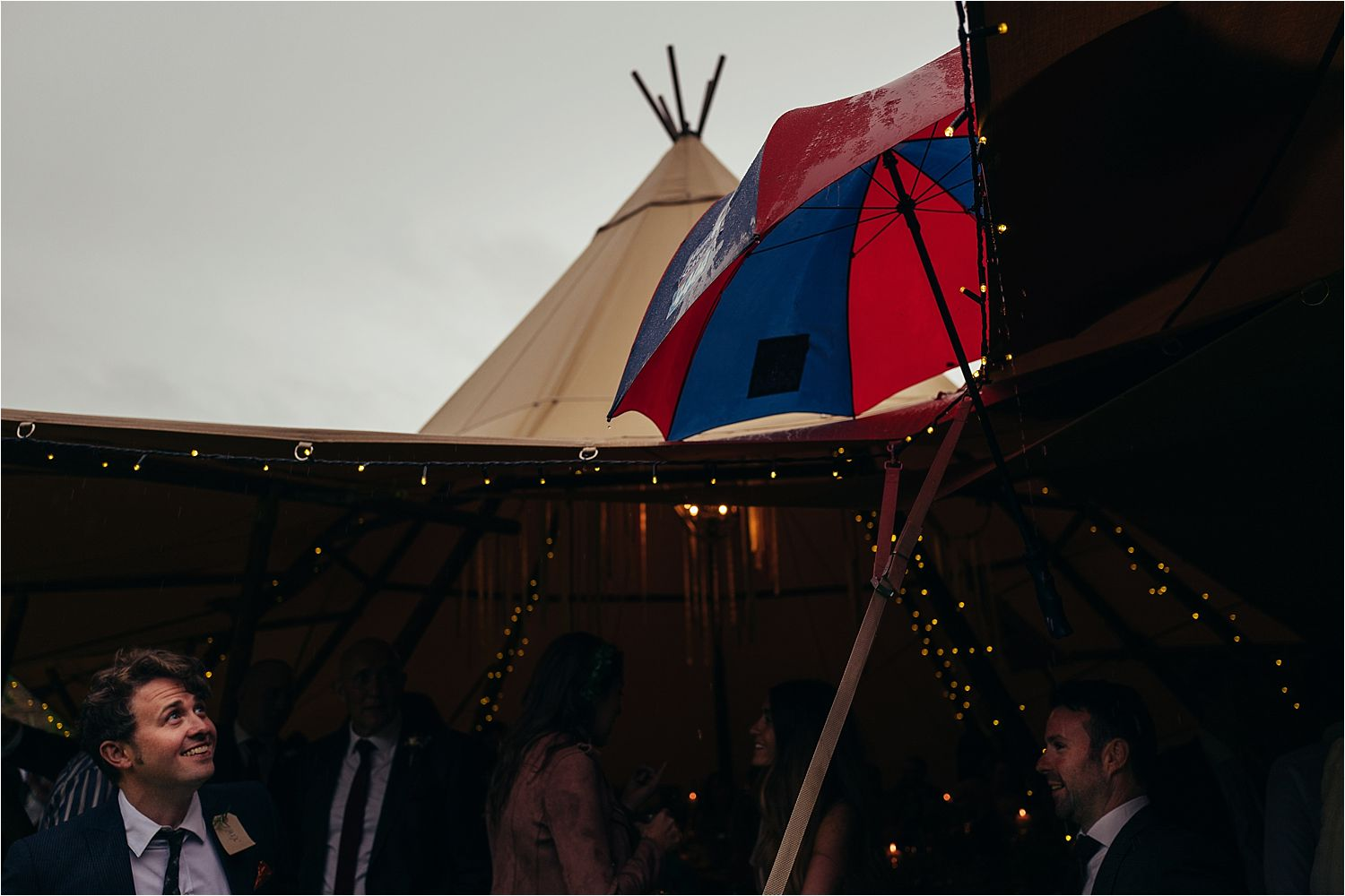 Umbrella up at tipi wedding in Bedfordshire