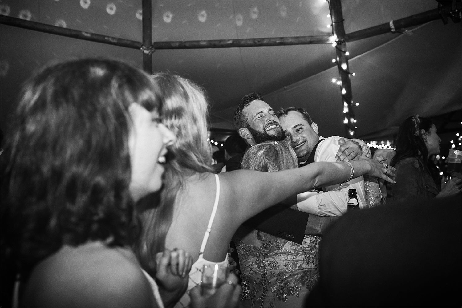 Bride and groom on dancefloor in tipi wedding party