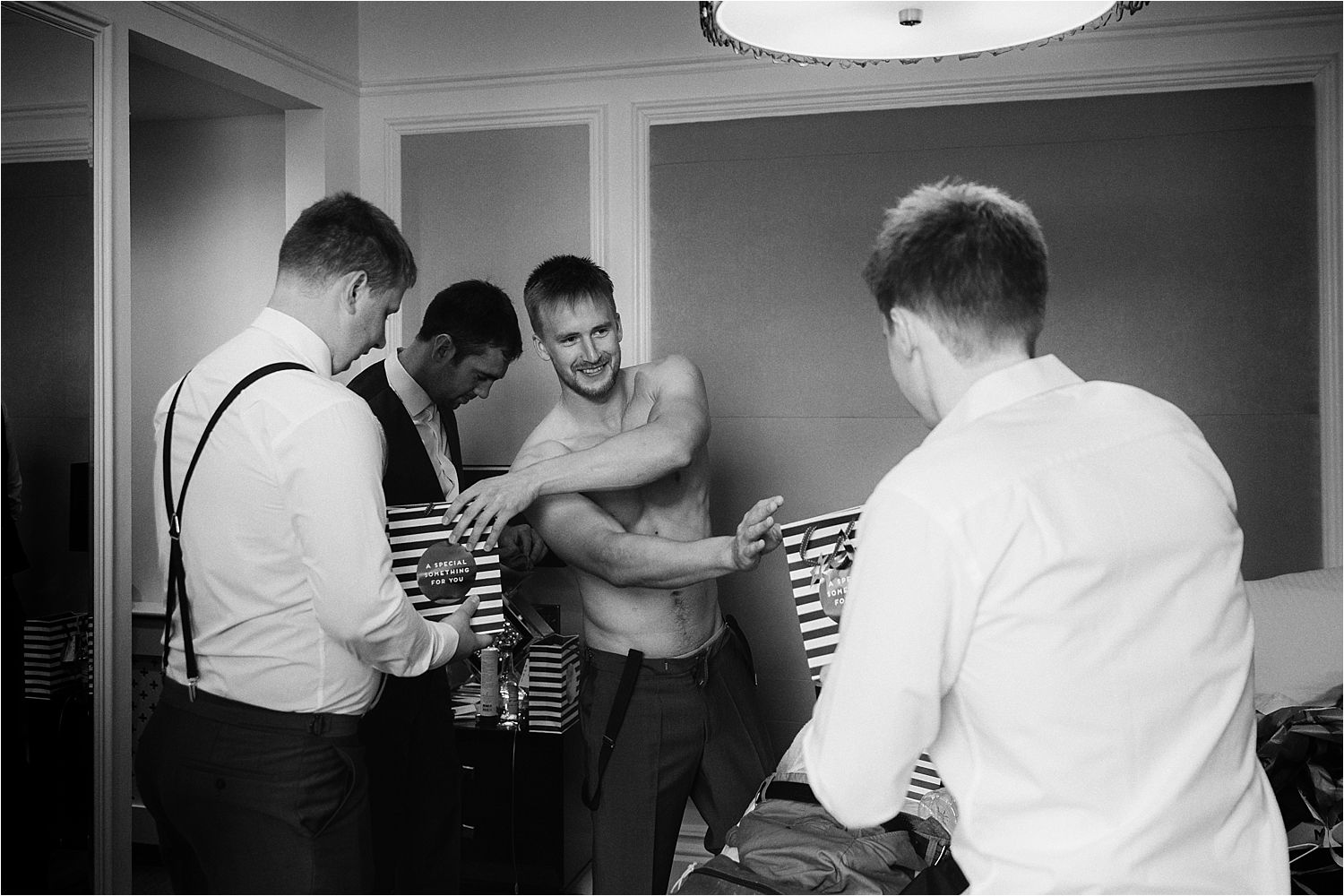 Bridegroom distributes gifts to his ushers at his Low Wood Bay wedding