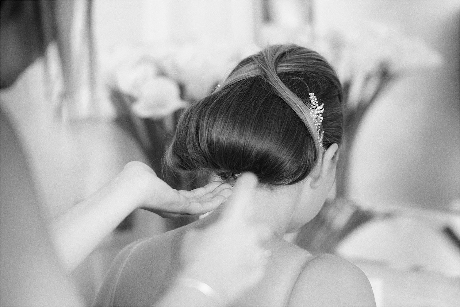 Finishing touches to bridal hair by Jo and Cass of Kendal and Lancaster