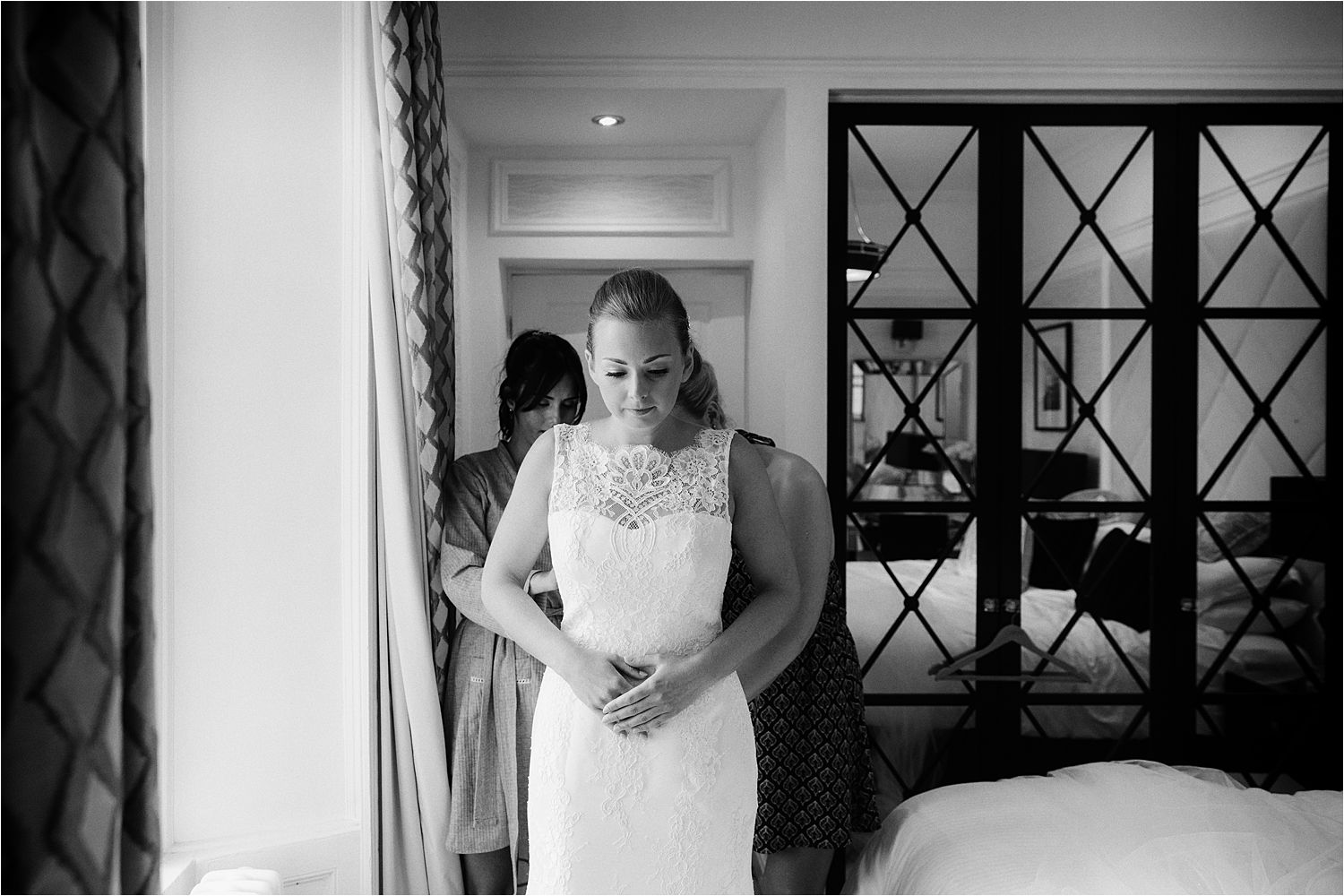 Bride getting ready into her Augusta Jones wedding gown prior to her Low Wood Bay wedding