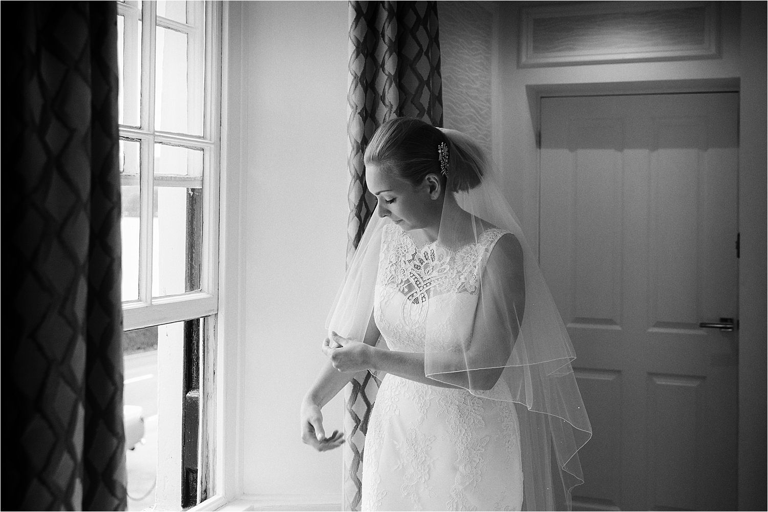 Bride dresses her veil prior to her wedding at Lake Disrtict wedding venue, Low Wood Bay