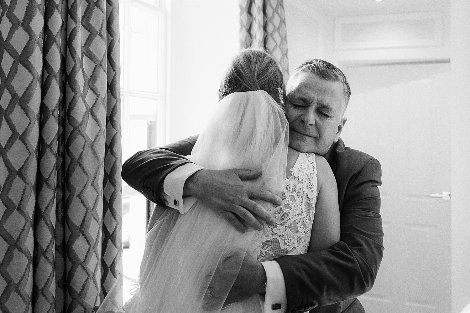 Bride gets a big hug from her father prior to her wedding at the Low Wood Bay