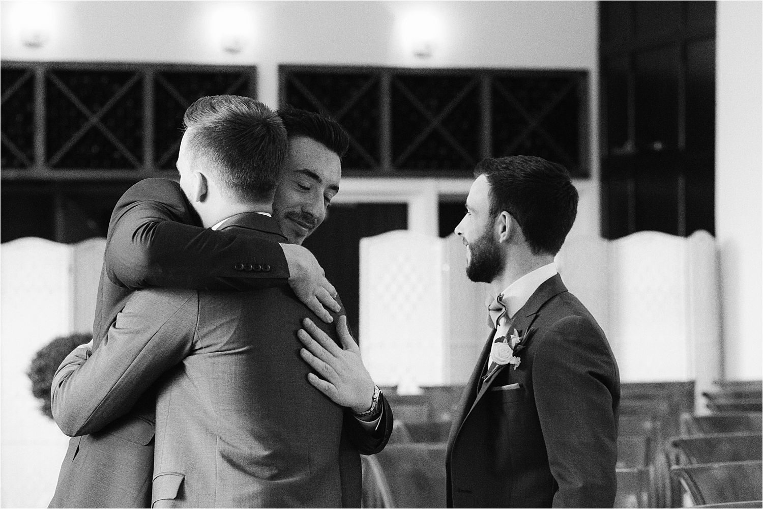 Bridegroom gets a man hug from a friend prior to his Lake District wedding