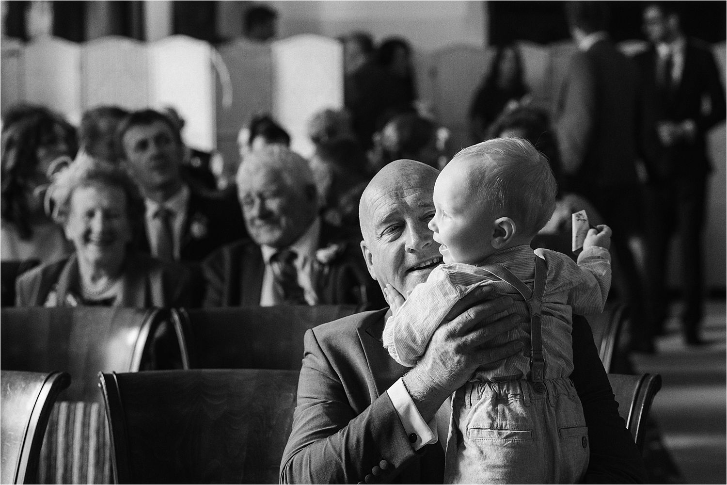 A baby in the congregation of guests at Low Wood Bay wedding