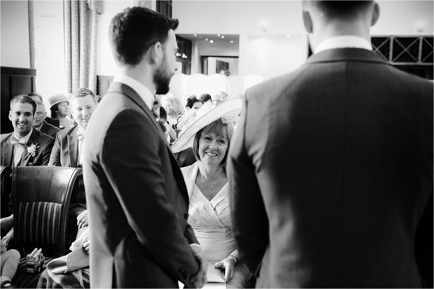Bridegroom's mother and grrom exchange a smile prior to the wedding ceremony at the Low Wood Bay
