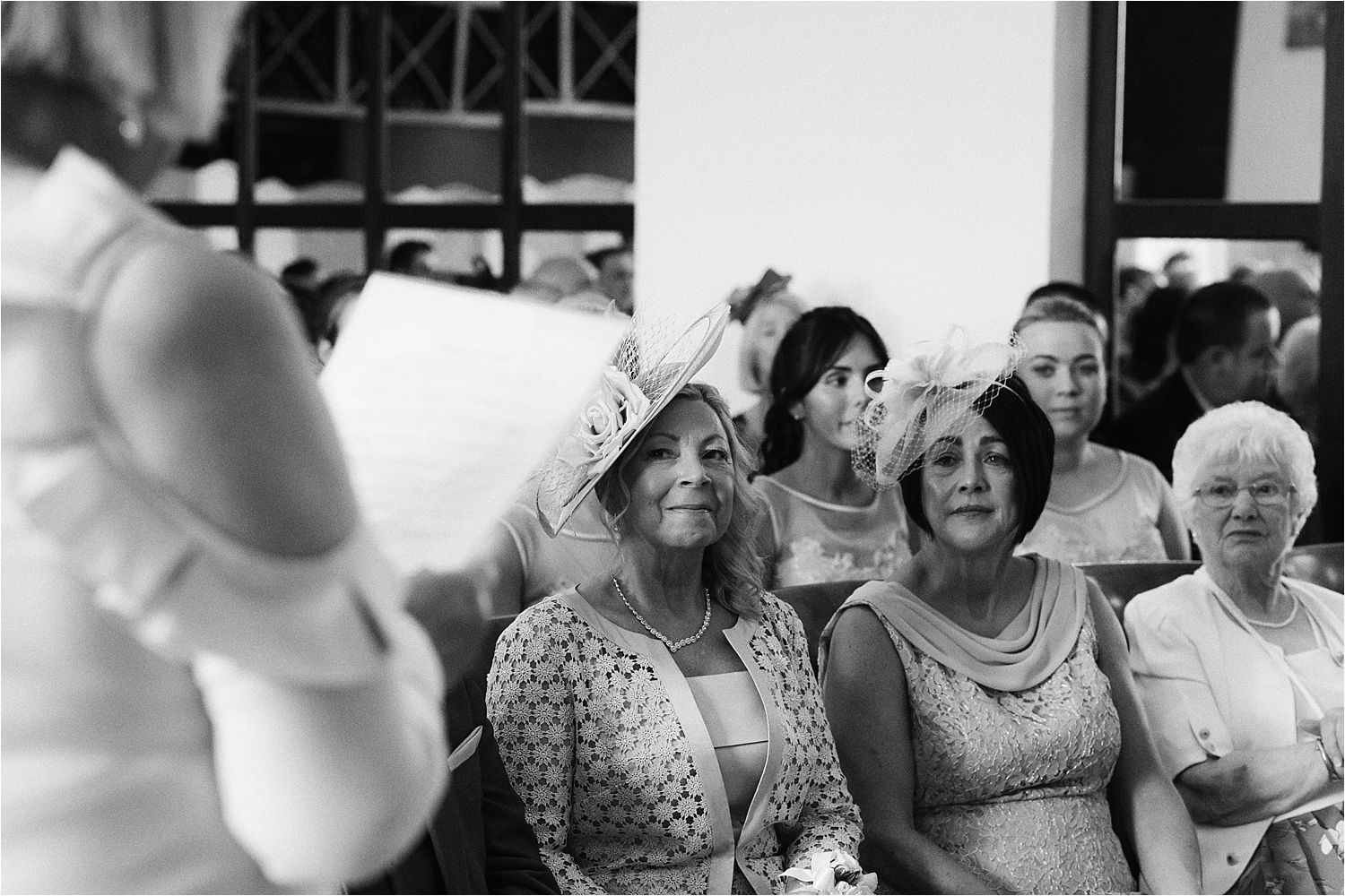 Bride's mum and guests listening to registrar at Lake District wedding