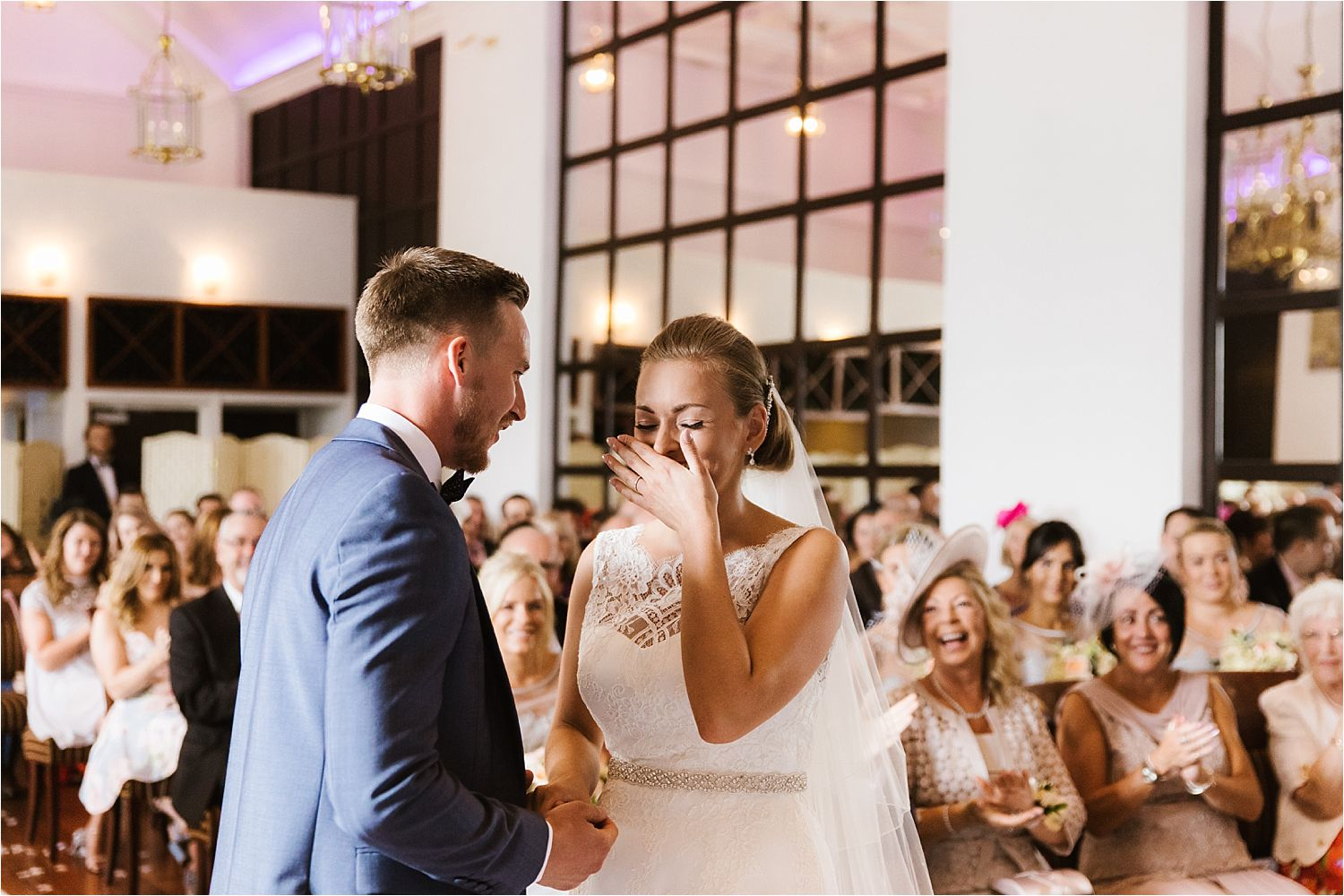 Bride erupts in laughter during vows at Low Wood Bay wedding