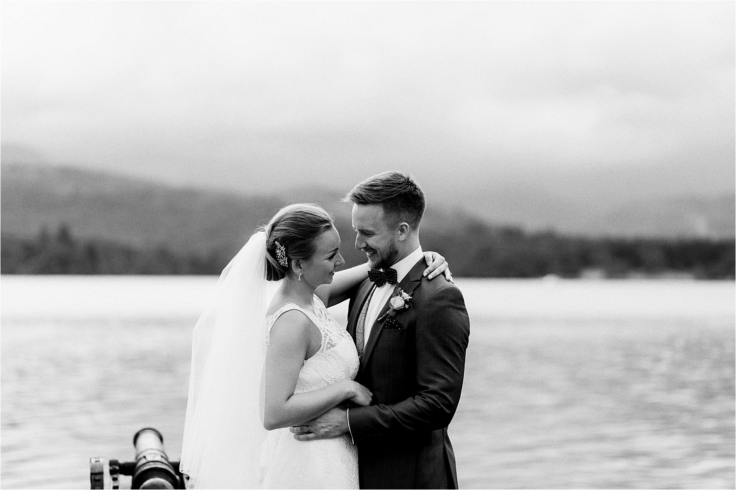 Bride and groom together on Lake Windermere jetty at the Low Wood Bay