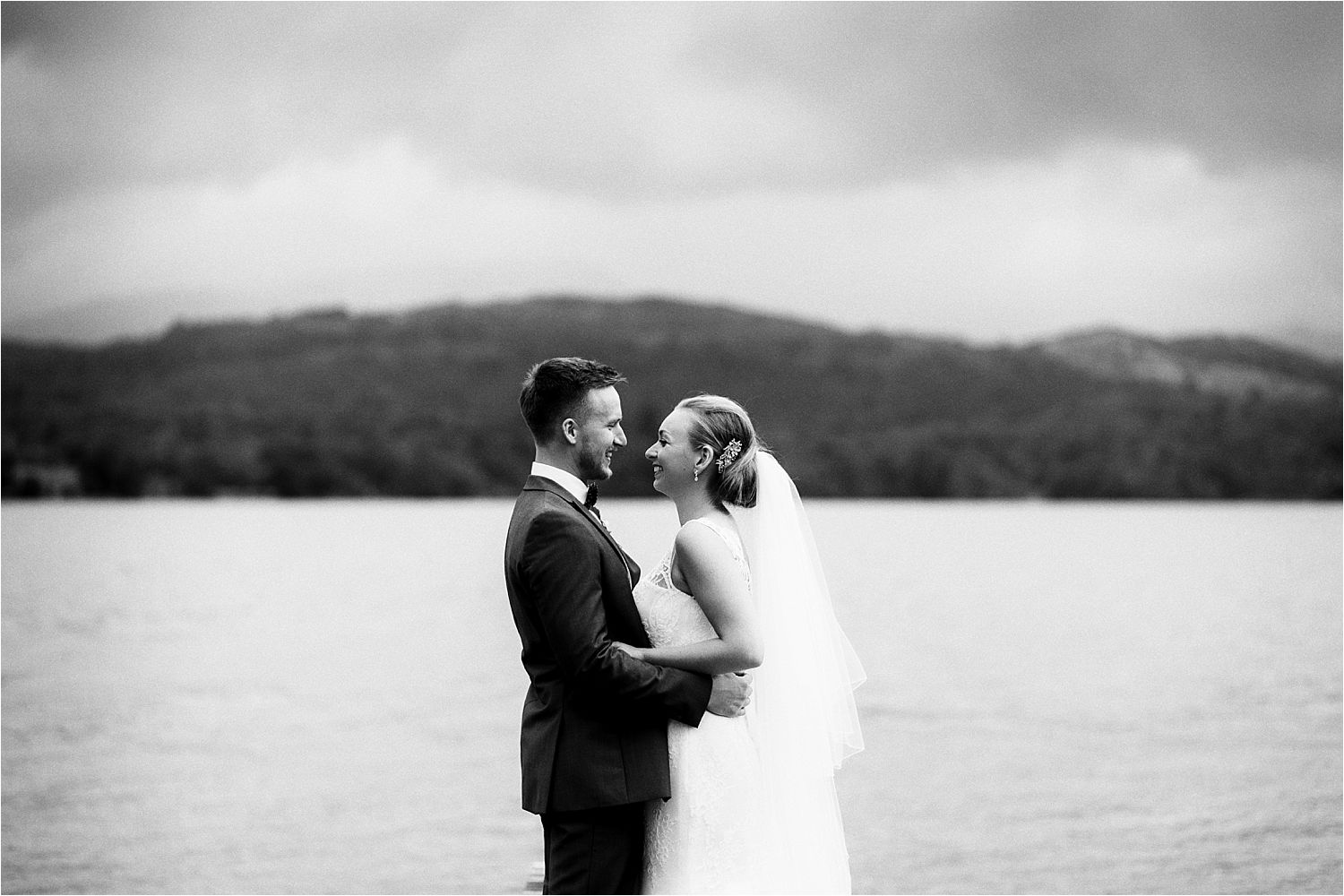Bride and groom on jetty at Low Wood Bay wedding