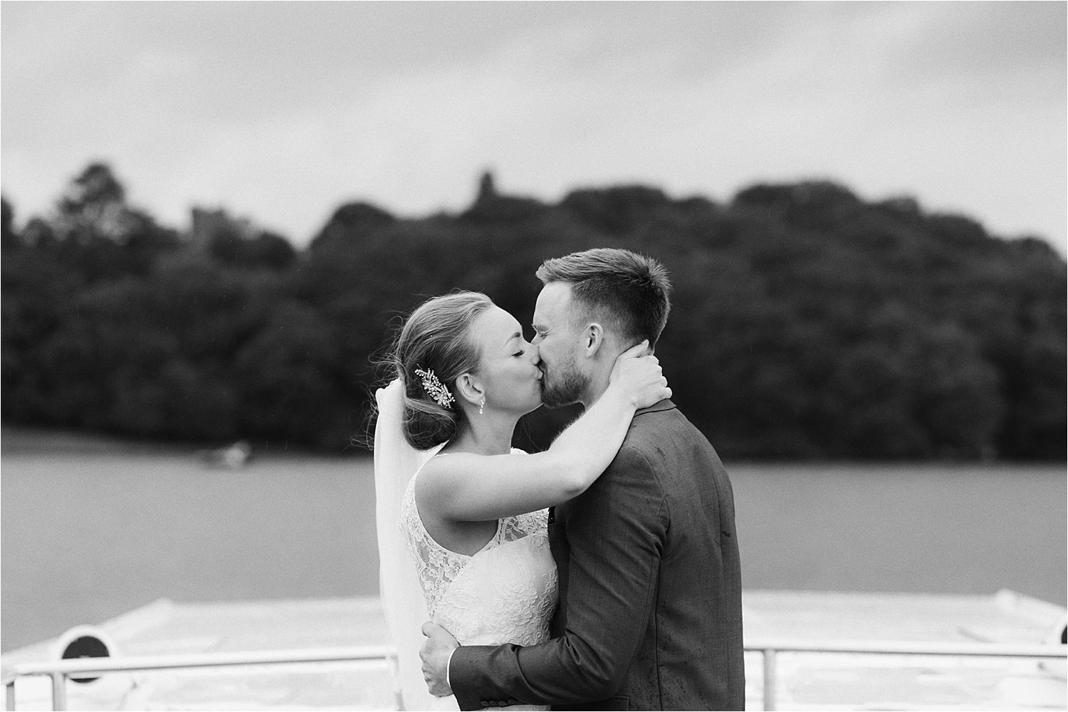 Wedding couple kissing on board Lake Windermere cruisers boat trip