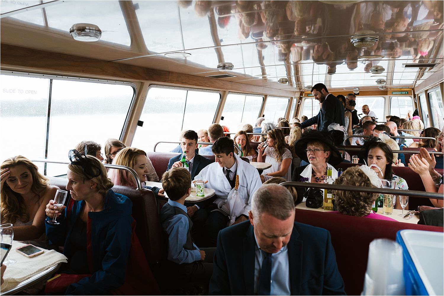 Wedding guests enjoying a cruise on Lake Winderemere fom the Low Wood Bay hotel