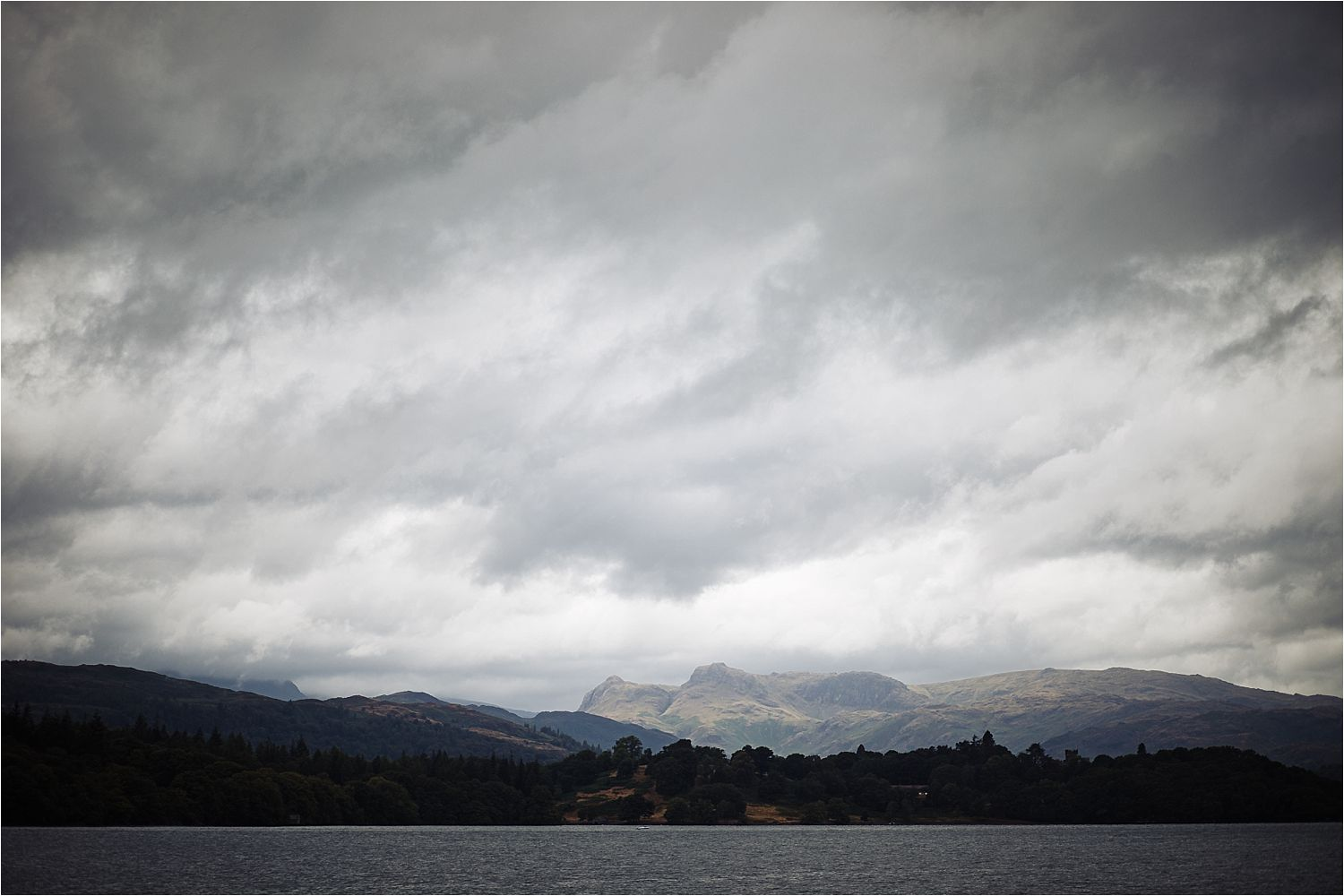 Lake District panoramic view from the middle of Lake Windermere.