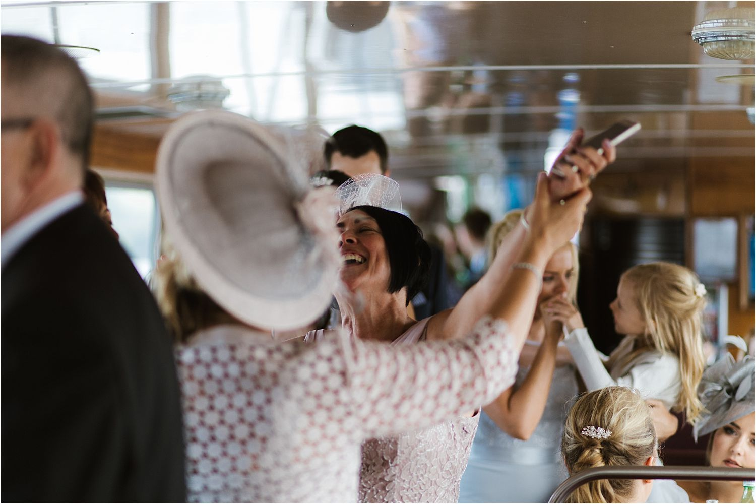 Wedding gurests partying on board a Lake Windermere Cruises steamer on Lake Windermere.