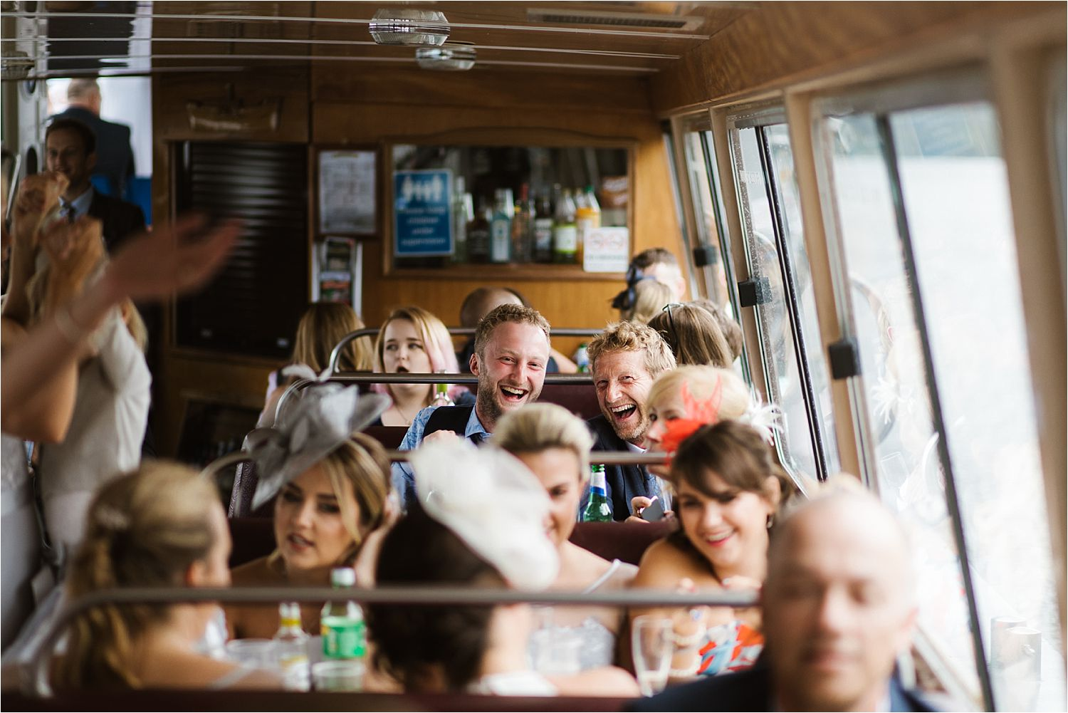 Party guests enjoying the cruise on Lake Windermere after Low Wood Bay wedding
