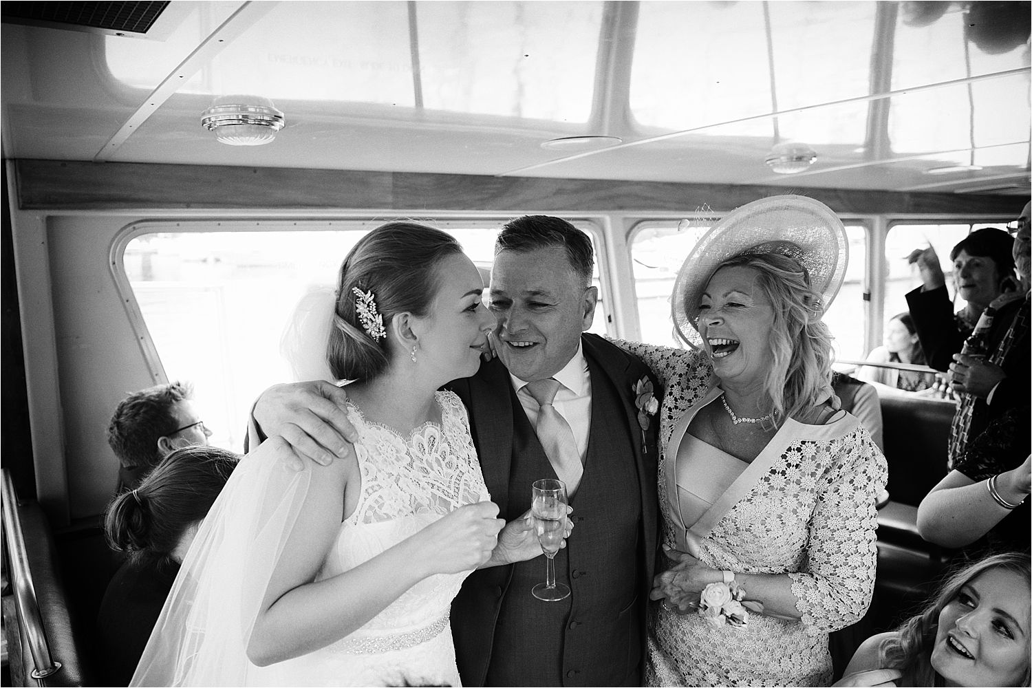 Bride with her mother and father on board a Lake Windermere Cruises steamer trip on the Lake