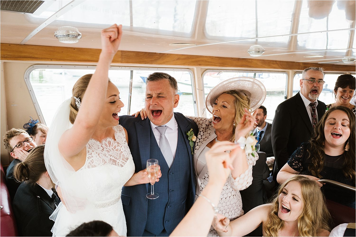 A party singalong on Lake Windermere cruise after Low Wood Bay wedding