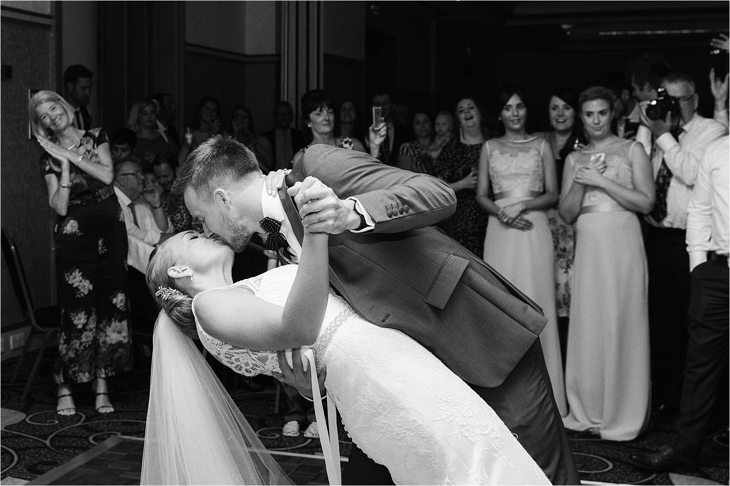 First dance kiss at evening wedding reception at the Low Wood Bay Hotel