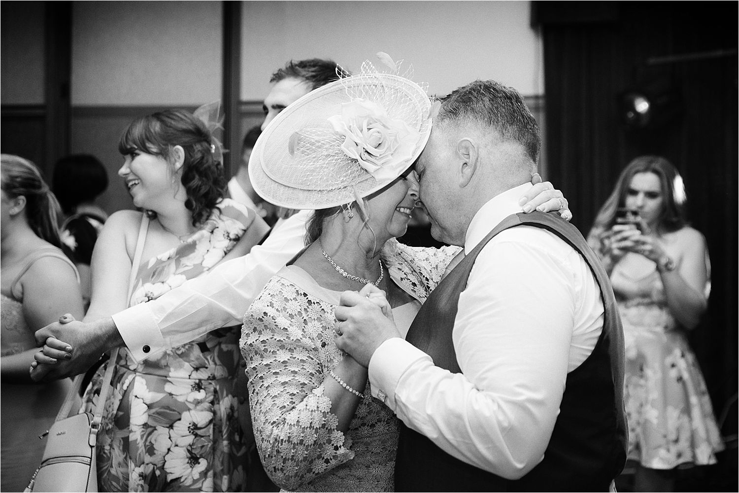 Mother and father of the bride enjoy a close dance at Lake District evening wedding party