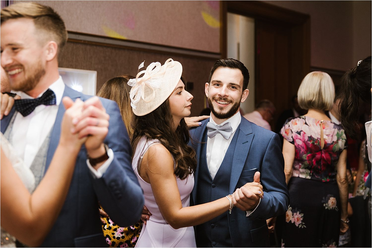 Best man and girlfriend on dancefloor at evening reception of Lake District wedding