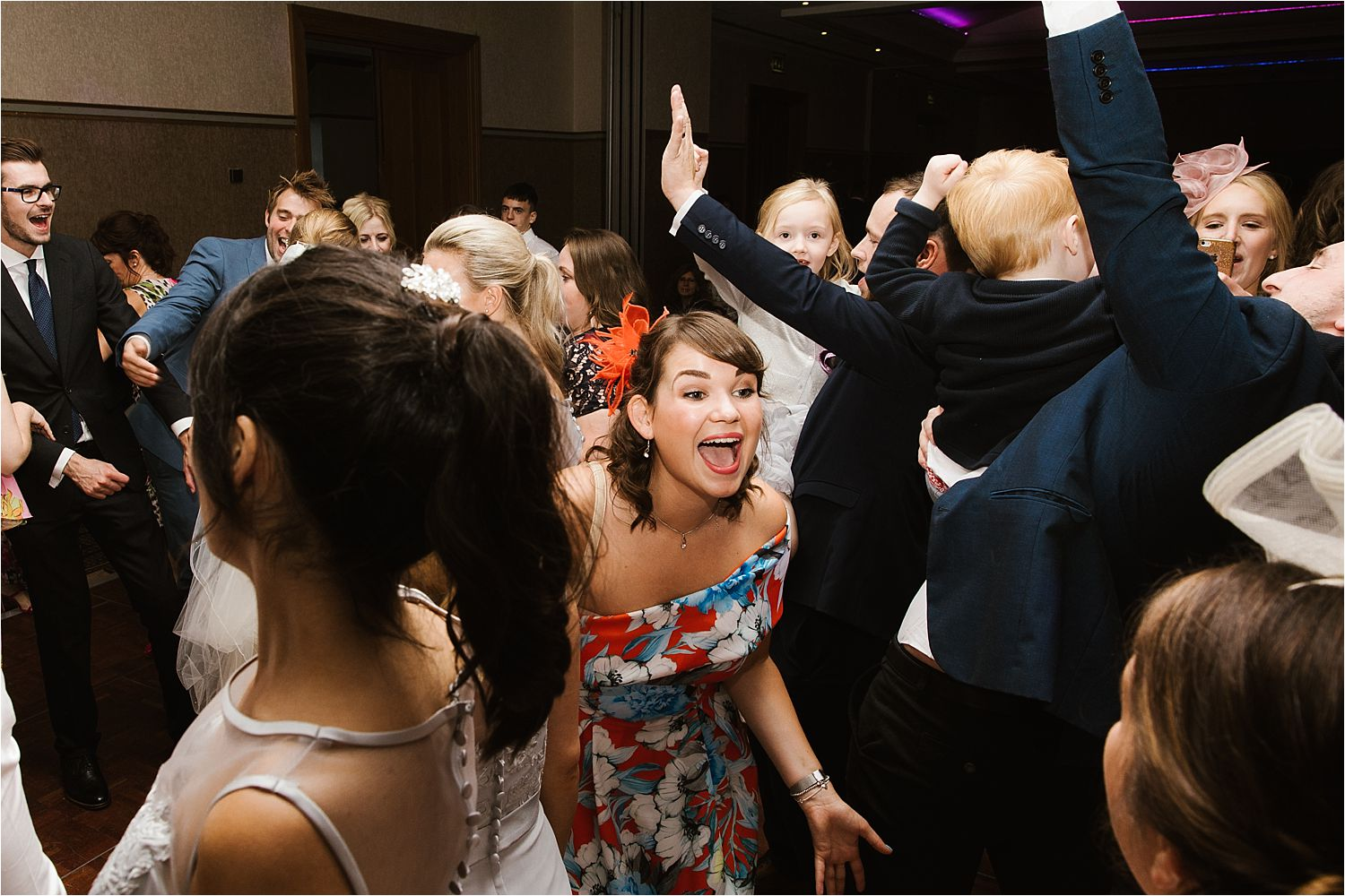 Evening wedding guests dancing the night away at Lake District wedding venue, Low Wood Bay