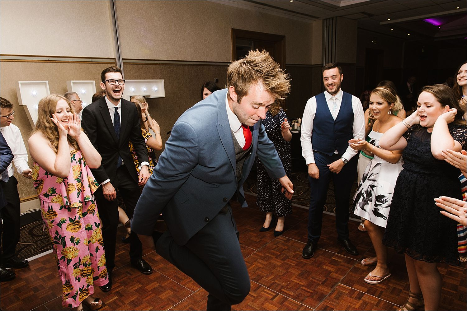 Dancing usher takes centre stage at Low Wood Bay evening wedding reception
