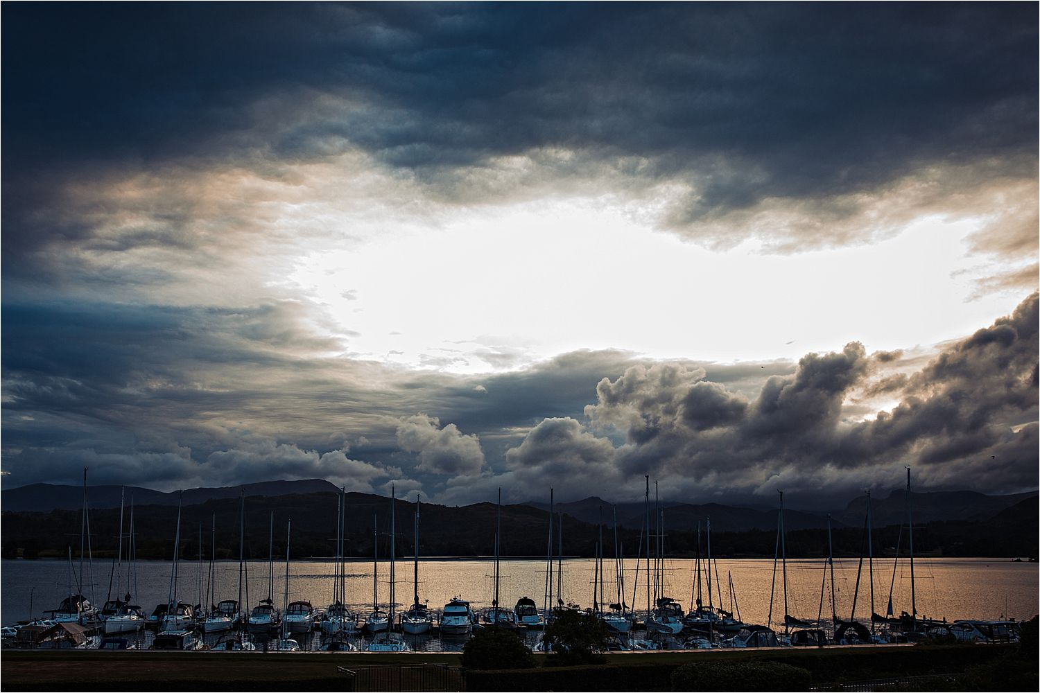 Sunset over the marina at the Low Wood Bay wedding venue, Lake District