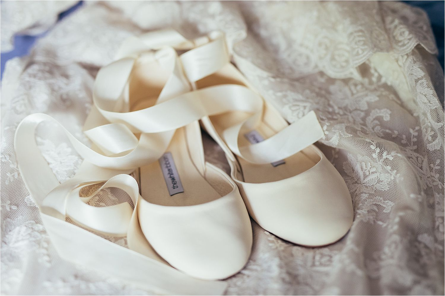 Wedding dress detail and shoes from Elizabeth Avey in London