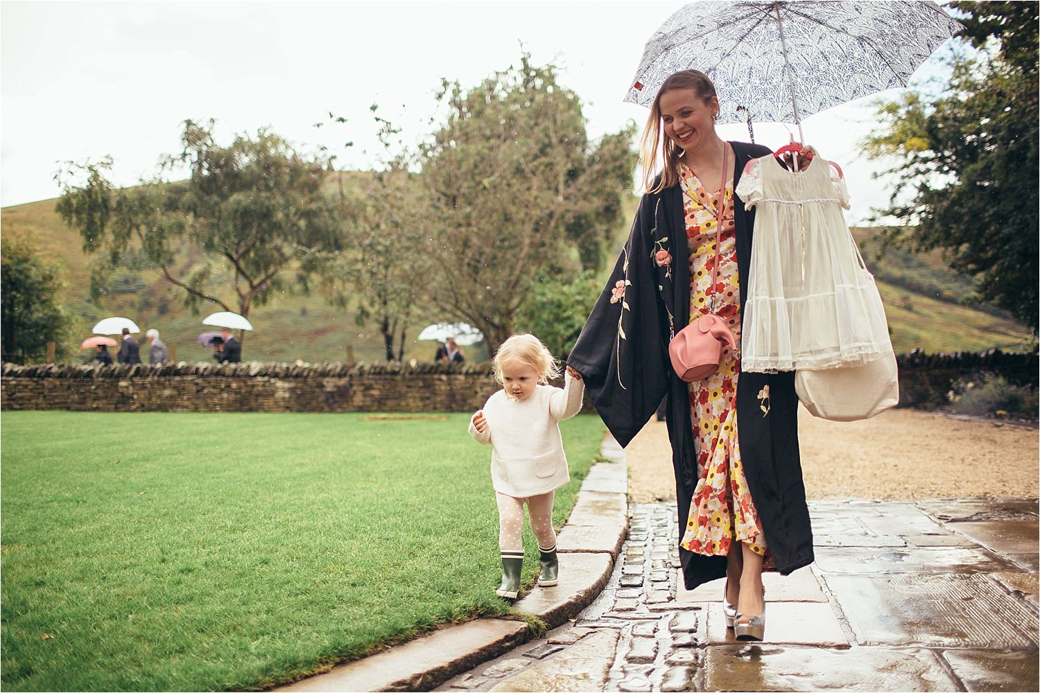 Little bridesmaid arriving with her mum to Manchester tipi wedding
