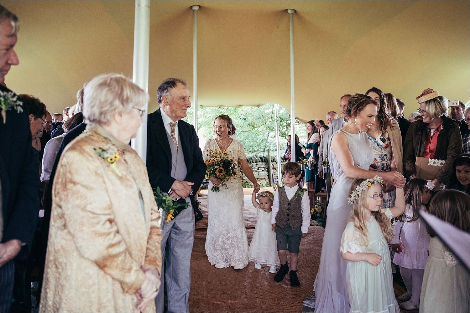 Bride and children arriving at North West tipi wedding
