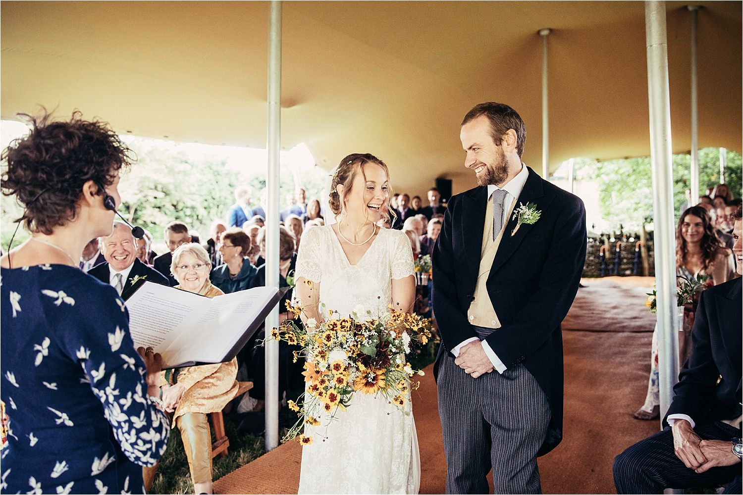 Bride and groom during tipi ceremony. Wedding dress by Elizabeth Avey, Vintage Bridal Wear and flowers by Fletcher and Foley
