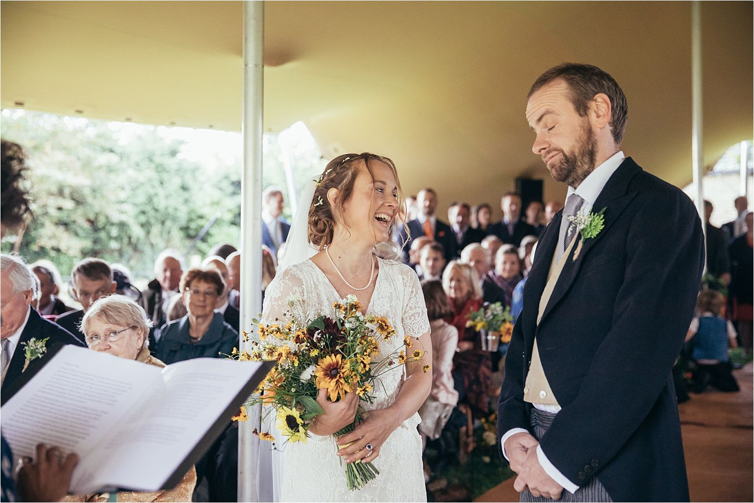 Exchange of vows at Manchester tipt wedding. Flowers by Fletcher and Foley, Manchester