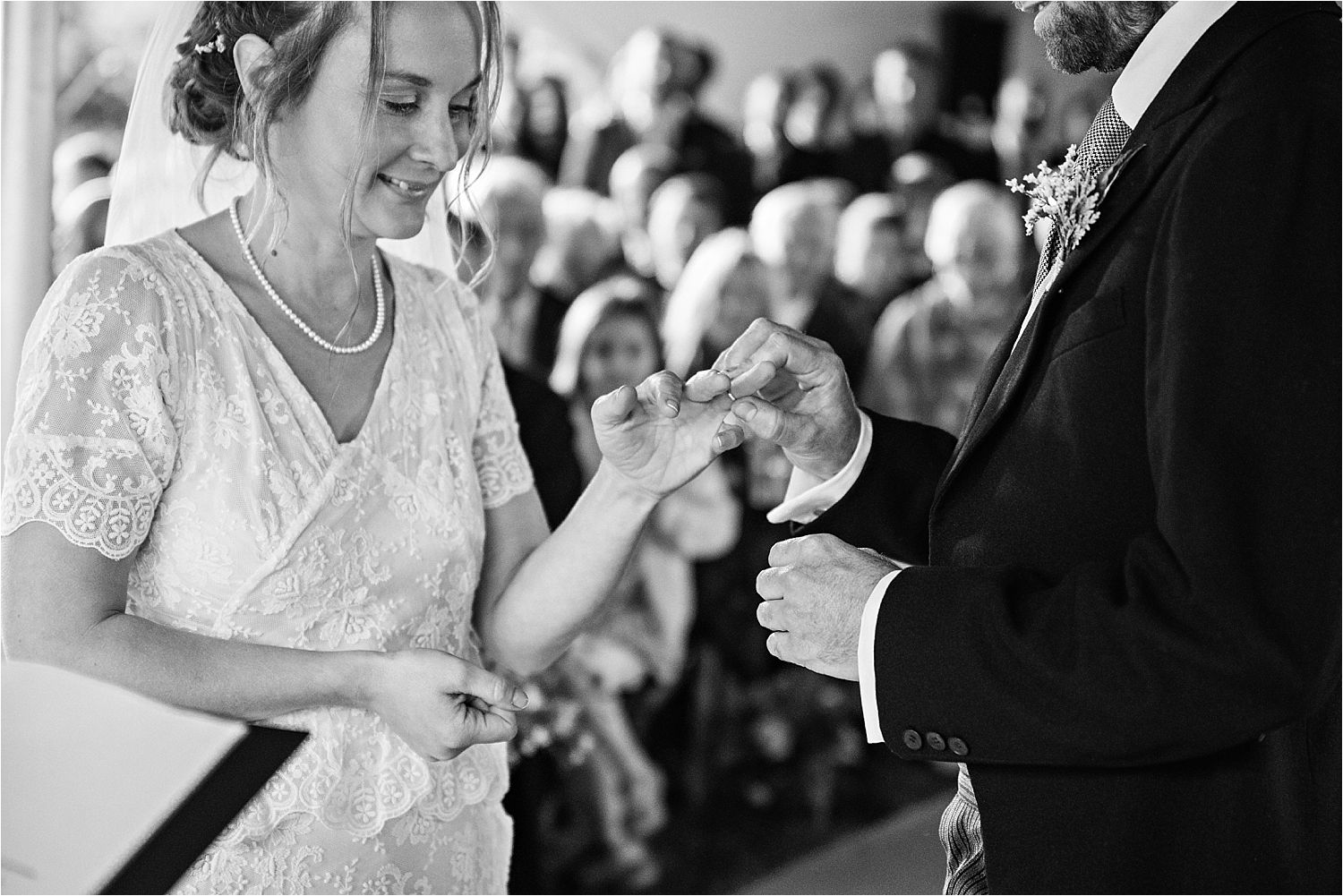 Exchnage of rings at Manchester tipi wedding ceremony. Dress by Elizabeth Avey of London