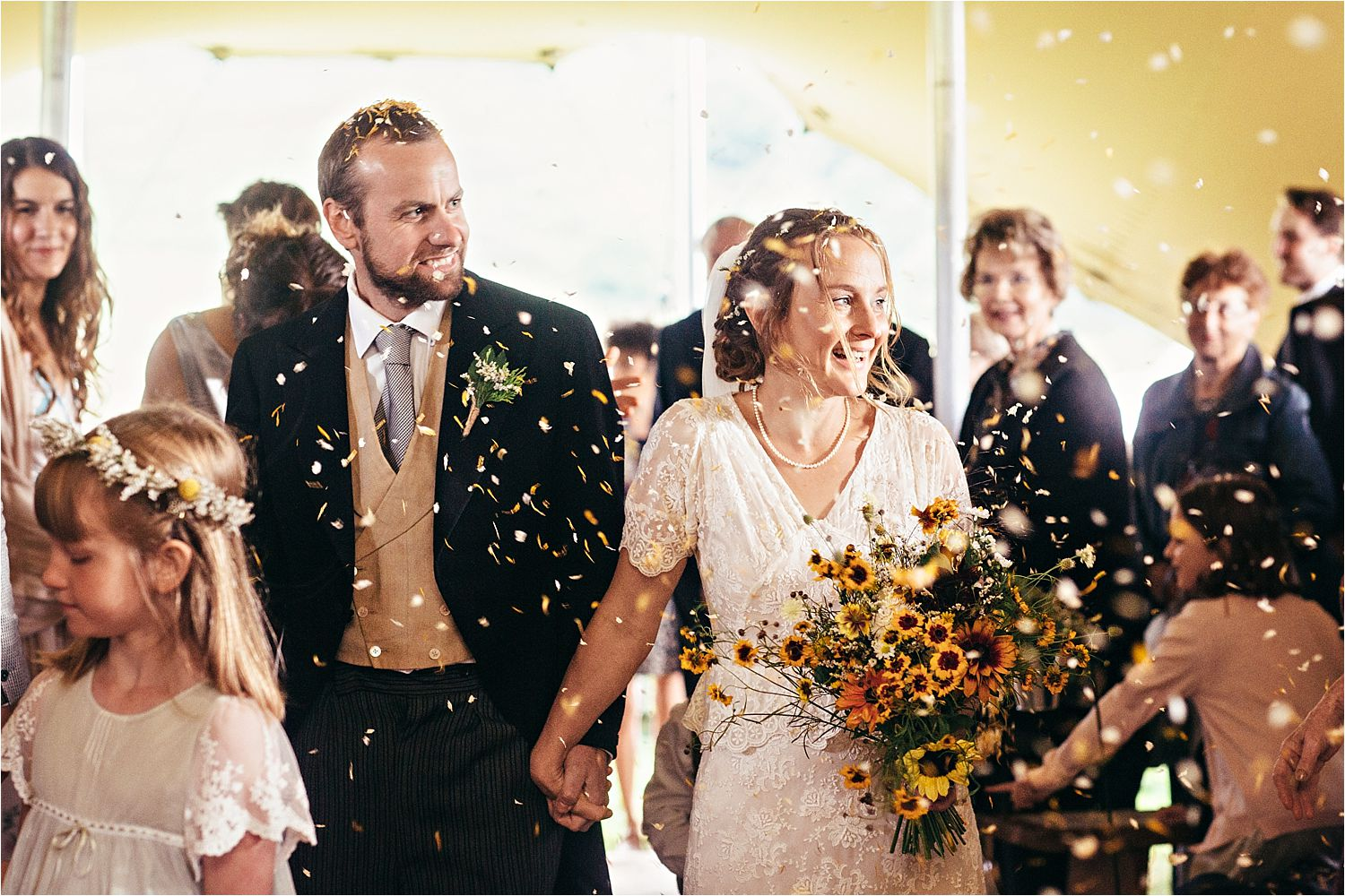 Confetti shower for bride and groom in Manchester tipi wedding