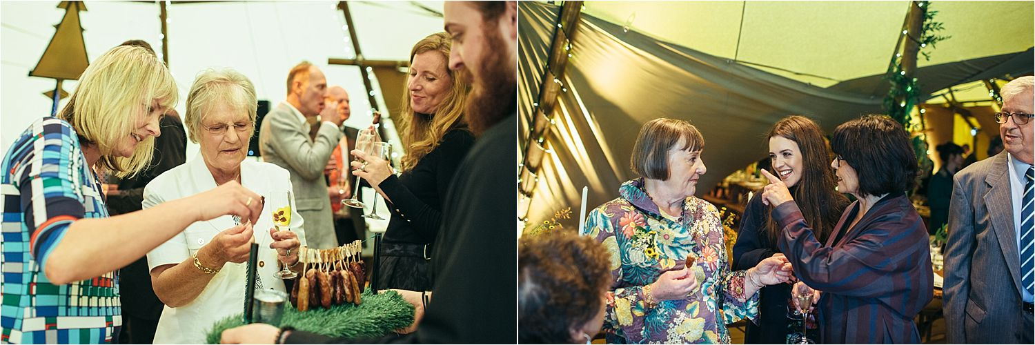 Guests enjoying canapes at Glossop tipi wedding