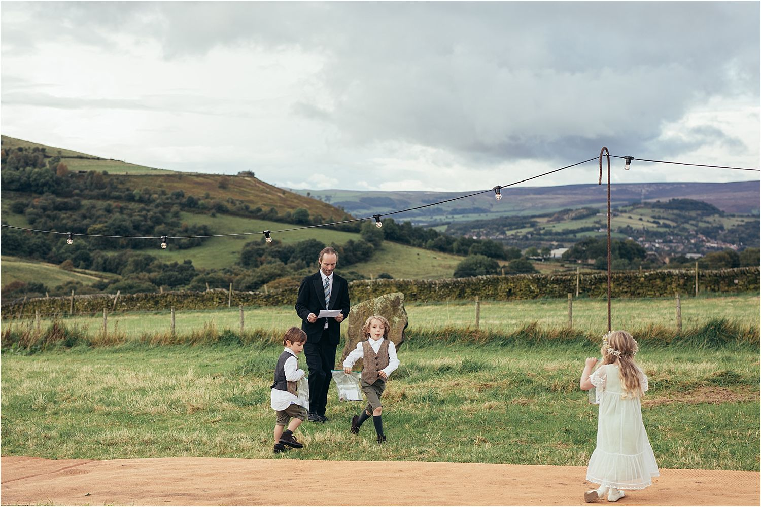 Children playing games at rural North West wedding