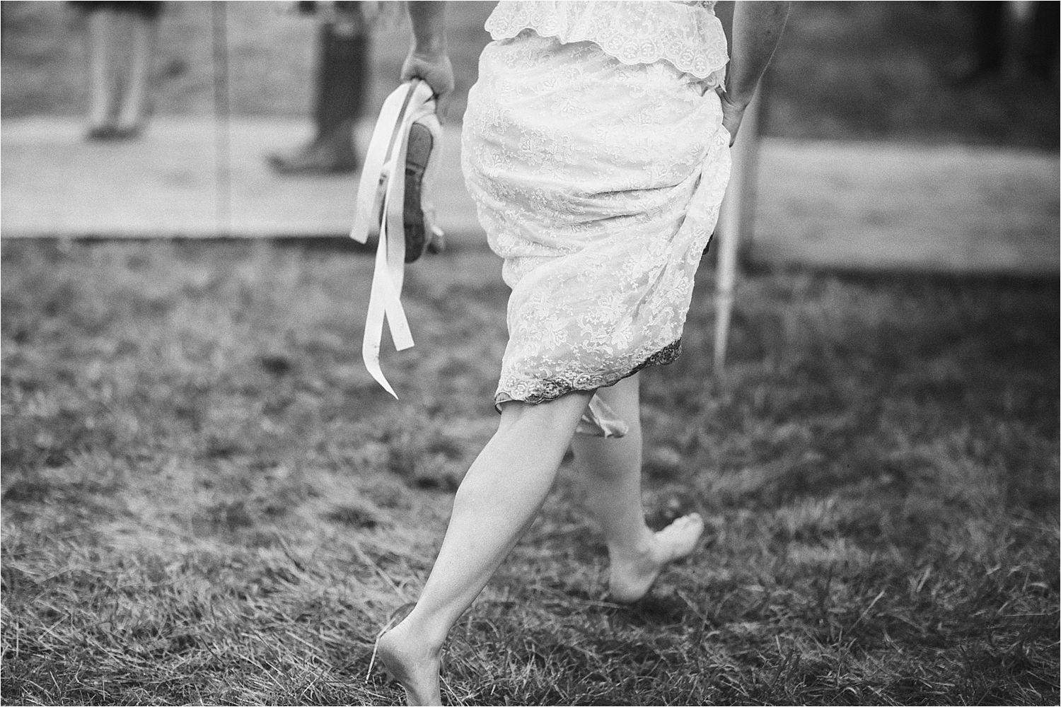 Bare foot bride at rural Manchester tipi wedding