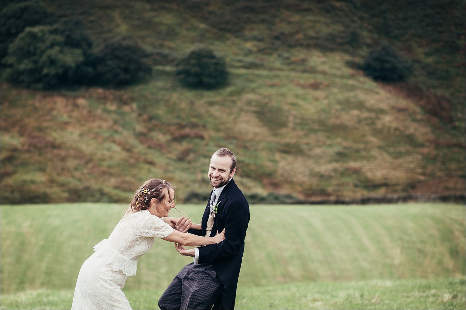 Bride and groom having fun at rural Manchester wedding