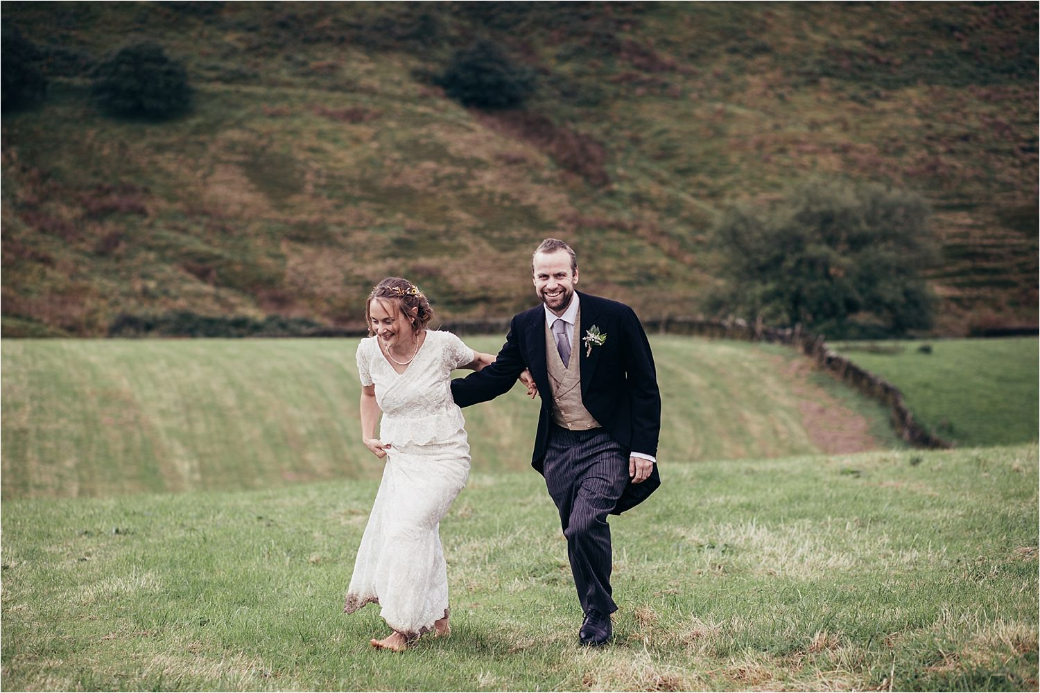 Bride and groom on moors at rural Manchester tipi wedding