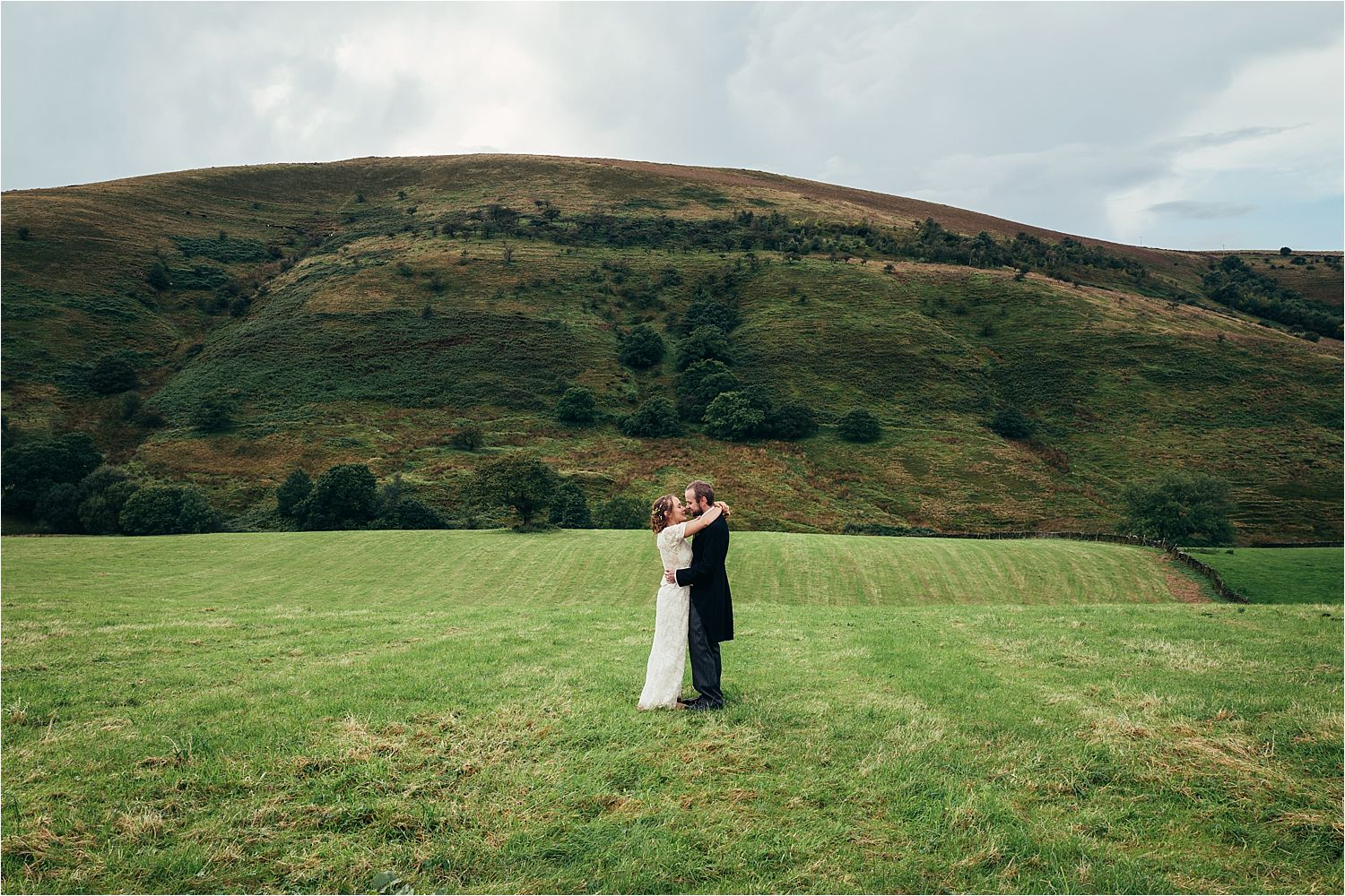 A kiss on the moors for manchester wedding couple