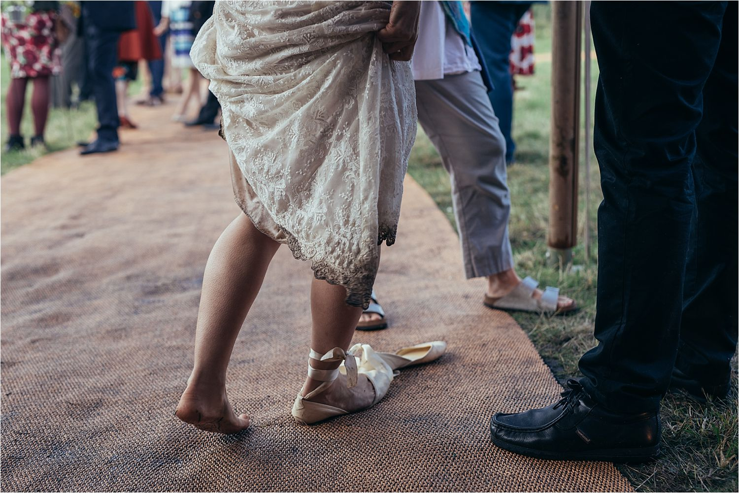 One shoe on, one shoe off for the bride at rural Manchester tipi wedding