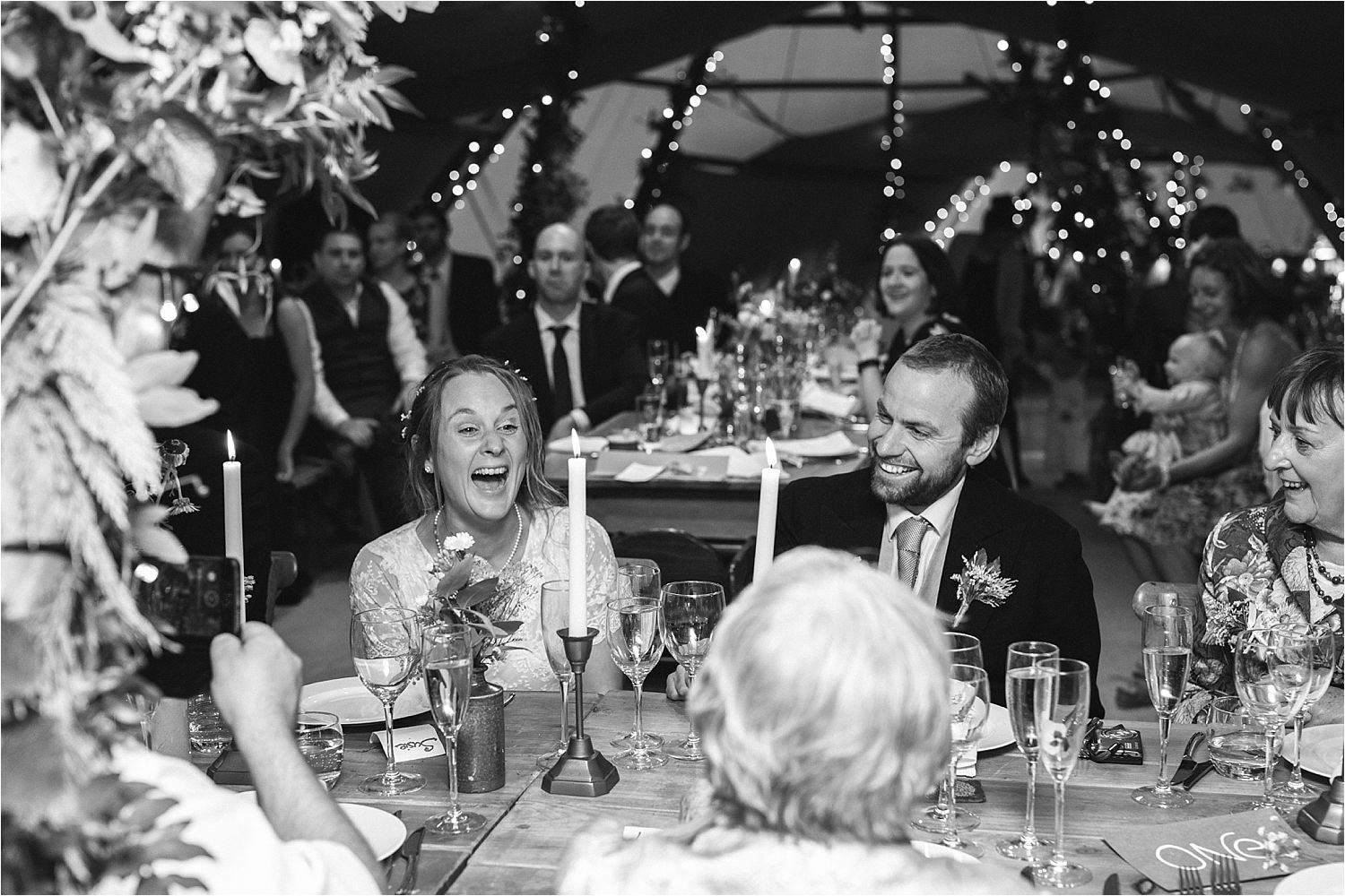 Bride and groom laughing during North west tipi wedding