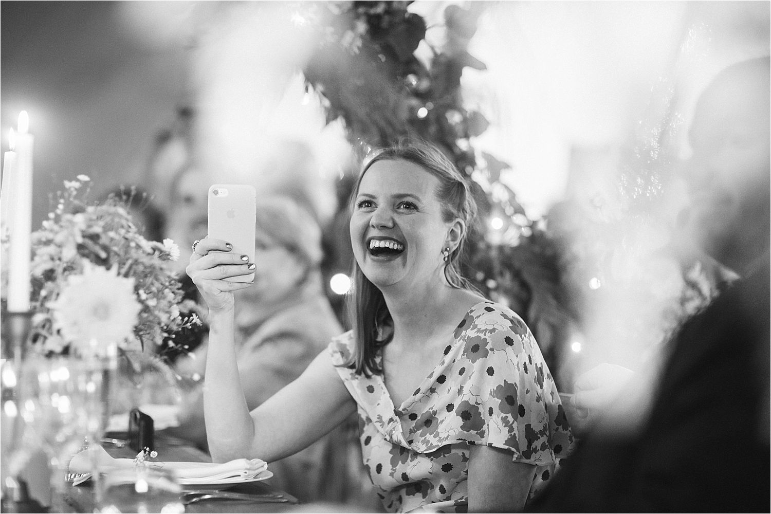 Guest capturing speeches on her phone at Manchester tipi wedding
