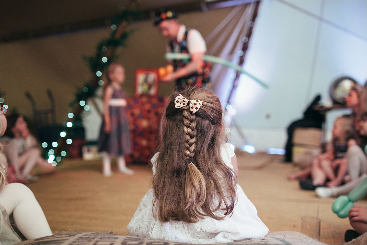 Back view of little girl's plait at Manchester tipi wedding reception